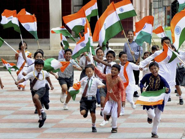 School-Kids-Running-With-Indian-Flags-Happy-Independence-Day-Of-India